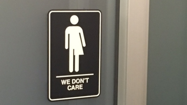 we-don-t-care-bathroom-sign